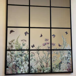 The final mirror created with IKEA mirrors and floral transfer