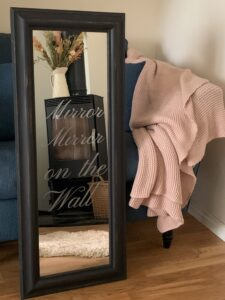 Photo of finished mirror with the words mirror mirror on the wall stencilled