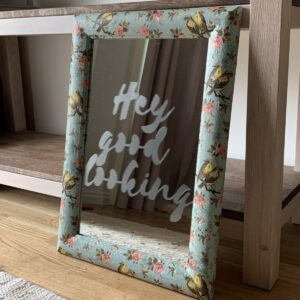 Final photo of charity shop mirror with hey good looking stencil