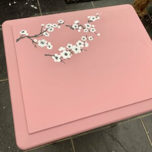 How to paint a layered cherry blossom stencil on a table