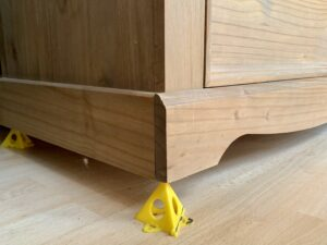 Pyramids used under a chest of drawers