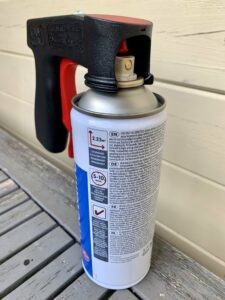 The spray paint handle on the spray can nozzle