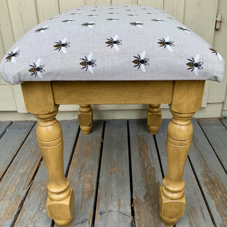 Black wax adding impact to a footstool